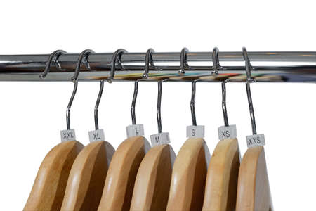 Wooden hangers with plastic sizes tags XXS, XS, S, M, L, XL, XXL are isolated on white Stok Fotoğraf