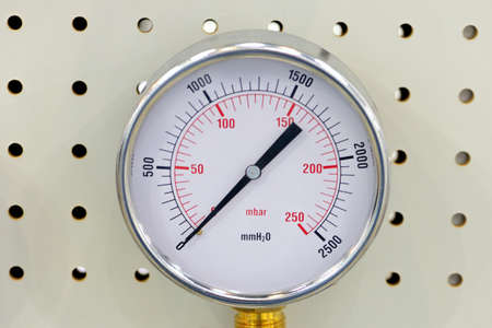 Pressure gauge, manometer - instrument for measuring the pressure of fluid on a metal plate with holes