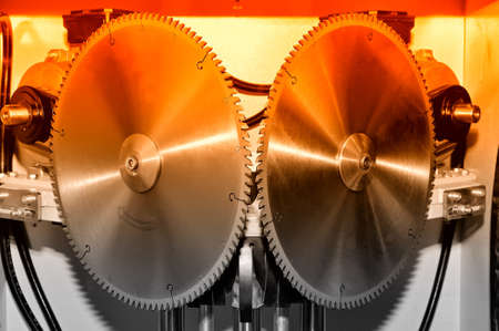 New modern industrial circular saw disks. Red toned image Stock Photo