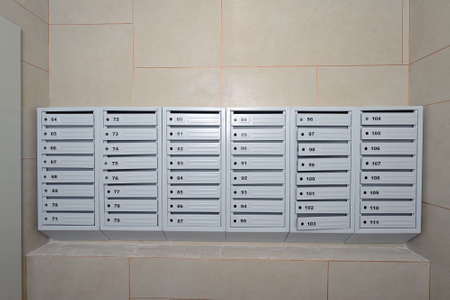 A lot of new mailboxes are still without locks in an apartment building Stock Photo