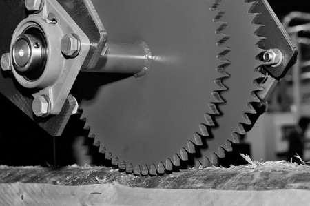 Industrial woodworking machine with circular saw disk. Milling machine for wood. Black and white toned image