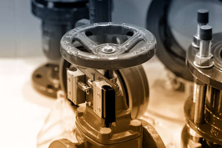 Big industrial valves. Manual valves. Butterfly valve with reducer. Brown toned Stock Photo