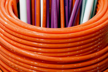 Colored plastic pipes for water supply. Shallow depth of field.