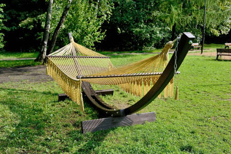 Rope hammock on wooden supports in the park.