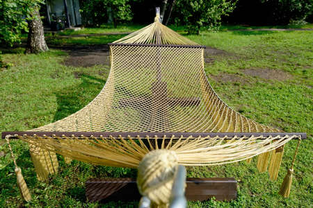 Rope hammock on wooden supports in the park