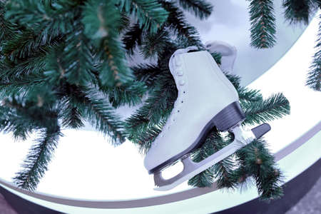 White skates for figure skating as a decoration of Christmas and New Year tree