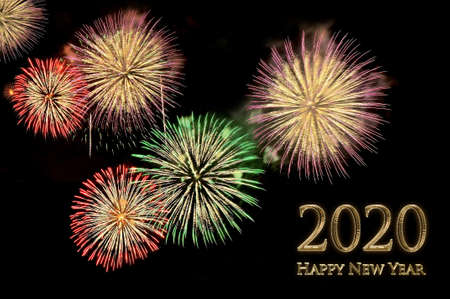 New year 2020 greeting card with gold letters Happy new year 2020 and flashes of festive fireworks salute on a black
