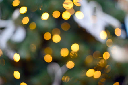 Blurry New Year and Christmas lights and Christmas toys. New Year and Christmas festive bokeh. Abstract background of garlands and Christmas toys.