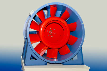 Large electric industrial fan on a blue 스톡 콘텐츠
