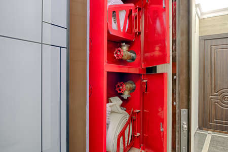 Fire hose reel in a residence building area.