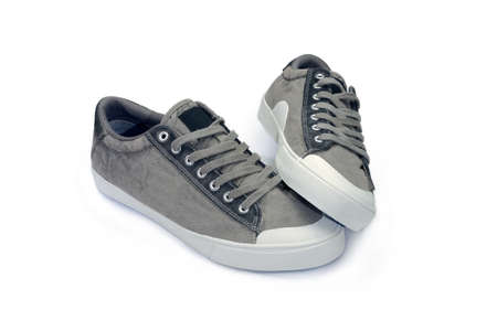 Pair of new gray mens shoes made of suede and textile. Фото со стока