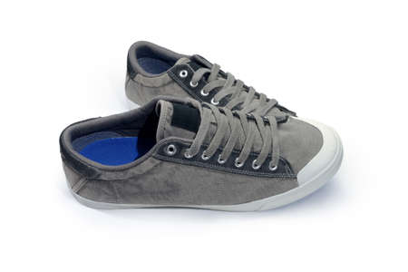 Pair of new gray mens shoes made of suede and textile. Mens casual boots isolated on a white background Фото со стока