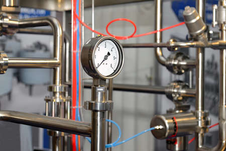 Pressure gauge of the pipeline in the production of dairy products.
