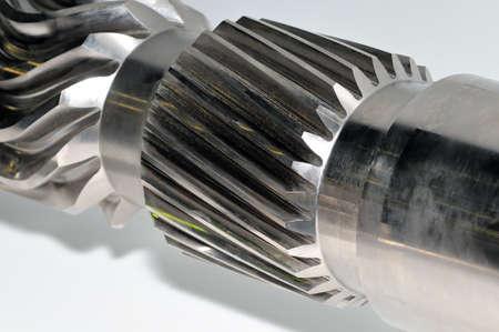 Industrial gear and a circular gear, cogwheel with spiral teeth. Фото со стока