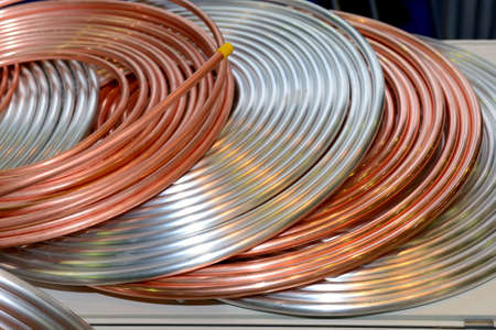 Copper and aluminum tubes for cooling systems, air conditioners rolled into a ring Фото со стока