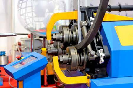 Industrial machine for bending steel pipes and metal rods. Pipe bending machine