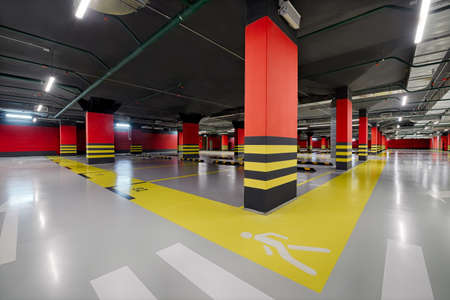 Large modern underground parking for cars. Empty, new not used underground car parking, garage