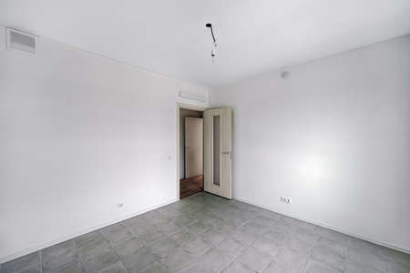 Empty room after repairs in an apartment building. Fresh renovated room with tile floor
