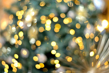 Abstract background lights and christmas toys. New Year and Christmas bokeh from burning lights and Christmas tree decorations Standard-Bild