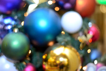 Blurry New Year and Christmas lights and Christmas toys. New Year and Christmas festive bokeh. Abstract background of garlands and Christmas toys Standard-Bild