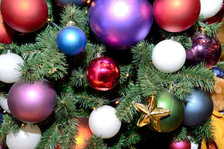 Multicolored Christmas tree toys in the form of balls on the New Year and Christmas tree