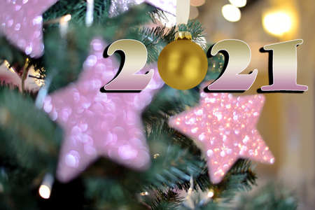 New Year card with blurry Christmas tree decorations background and date 2021