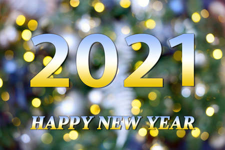 New year card with background of blurry lights of New Year and Christmas tree and text 2021 Happy New Year Standard-Bild