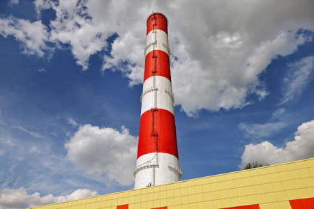 View of the thermal power plant, chimney against blue sky. Concept: air pollution, global warming