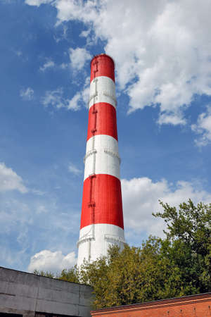 View of the thermal power plant, chimney against blue sky. Concept: air pollution, global warming Standard-Bild - 163158075