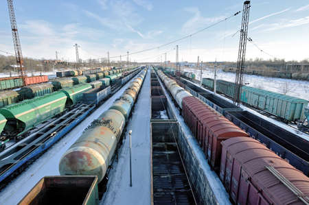 Moscow region, Russia, February 27, 2021: Big cargo freigt train railroad station. Railroad station in the Moscow region with different freight cars for composing freight trains