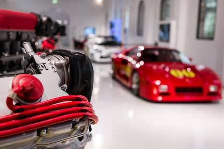 MODENA, ITALY - May, 2017. Museum Enzo Ferrari exhibit a race engine and Ferrari 288 GTO Evoluzione Редакционное
