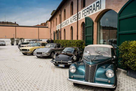 Modena, Italy - March, 2018. Classic and vintage cars on display in the square of the Enzo Ferrari museum house on the occasion of the Concours d'Elegance Trofeo Salvarola Terme