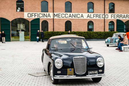 Modena, Italy - March, 2018. Classic and vintage Fiat cars leave the square of the Enzo Ferrari museum house on the occasion of the Concours d'Elegance Trofeo Salvarola Terme