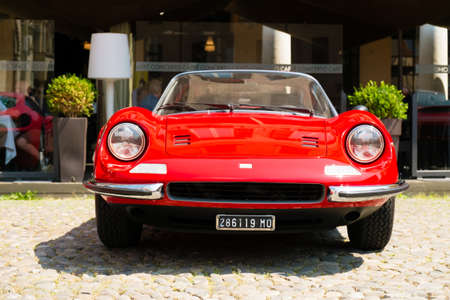 MODENA, ITALY - June, 2018. A Ferrari Dino in the Piazza Grande square