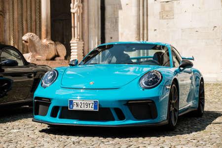 MODENA, ITALY - June, 2018. A Miami blue Porsche 911 GT3 in the Piazza Grande square Stock Photo - 111809357