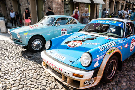 MODENA, ITALY - June, 2018. An Alfa Romeo Giulietta Sprint of 1957 and Porsche 911 SC of 1981 in Piazza Grande at the end of the race Modena 100 ore Classic