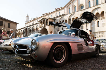 MODENA, ITALY - June, 2018. Left view of a Mercedes Benz 300 SL Gullwing of 1956 with open doors in Piazza Grande