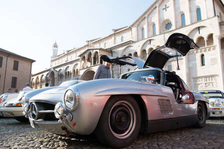 MODENA, ITALY - June, 2018. Left view of a Mercedes Benz 300 SL Gullwing of 1956 with open doors in Piazza Grande Sajtókép