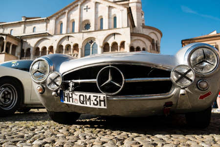 MODENA, ITALY - June, 2018. Front side view of a Mercedes Benz 300 SL Gullwing of 1956 in Piazza Grande Editoriali