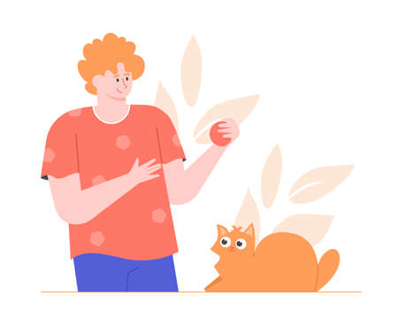 Man with a ball and a ginger cat. Stockfoto