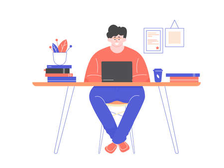 Freelancer man in glasses at desk with laptop.