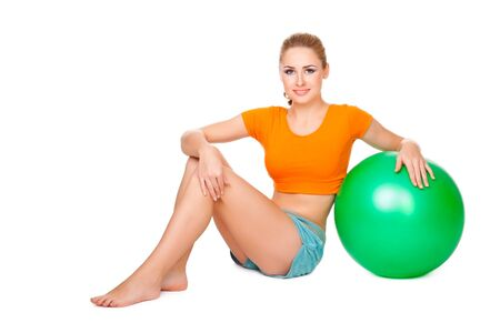 Pretty blond girl making sport with a ball