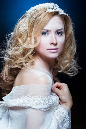 The beautiful blond girl with a winter make-up