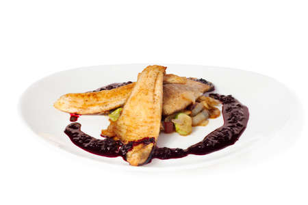 Fish a grill with grilled vegetables with berry sauce Stock Photo