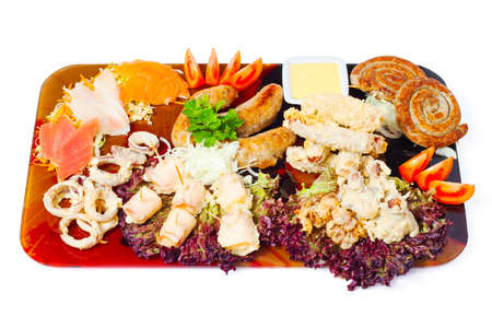 Meat a grill and seafood on a tray isolated on white background