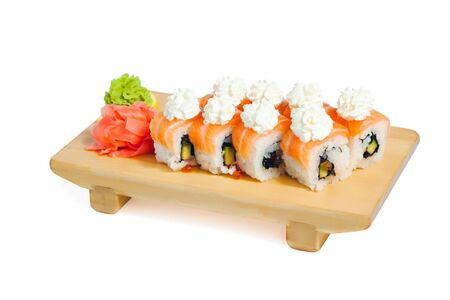 Asian food sushi on wooden plate isolated on white background Stock Photo