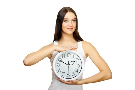 The girl with clock in hands on a white background
