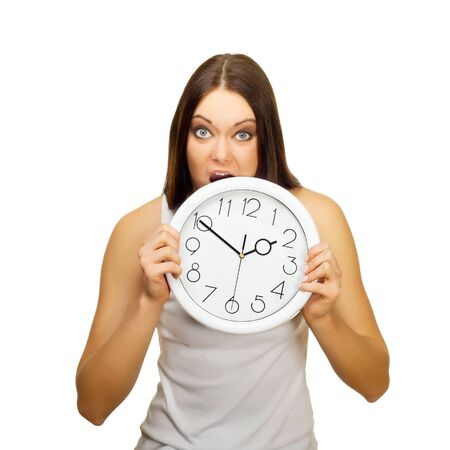 The angry girl bites clock , on a white background