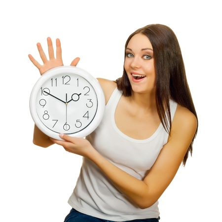 The girl with clock in hands is happy on a white background