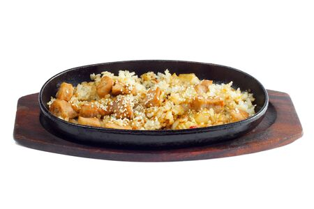 Rice and meat fried in a frying pan on a white background